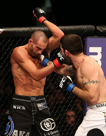 SEATTLE, WA - DECEMBER 08:  (R-L) Matt Brown punches Mike Swick during their welterweight bout at the UFC on FOX event on December 8, 2012  at Key Arena in Seattle, Washington.  (Photo by Ezra Shaw/Zuffa LLC/Zuffa LLC via Getty Images) *** Local Caption *** Mike Swick; Matt Brown