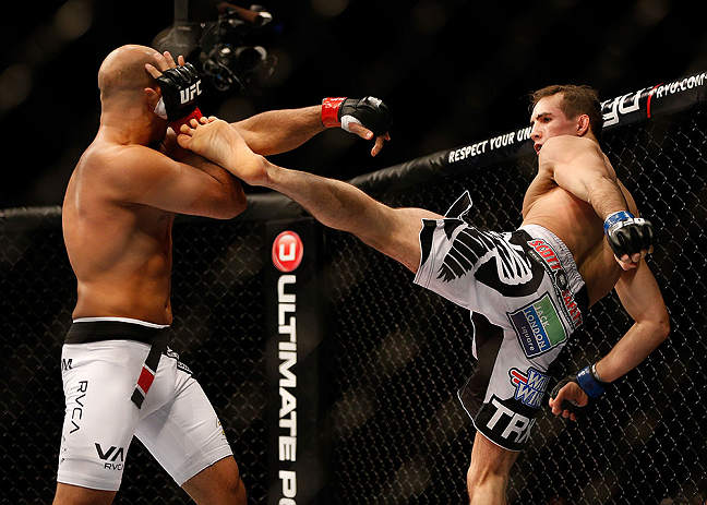 SEATTLE, WA - DECEMBER 08:  (R-L) Rory MacDonald kicks BJ Penn during their welterweight bout at the UFC on FOX event on December 8, 2012  at Key Arena in Seattle, Washington.  (Photo by Josh Hedges/Zuffa LLC/Zuffa LLC via Getty Images) *** Local Caption *** BJ Penn; Rory MacDonald