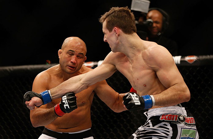 SEATTLE, WA - DECEMBER 08:  (R-L) Rory MacDonald punches BJ Penn during their welterweight bout at the UFC on FOX event on December 8, 2012  at Key Arena in Seattle, Washington.  (Photo by Josh Hedges/Zuffa LLC/Zuffa LLC via Getty Images) *** Local Caption *** BJ Penn; Rory MacDonald