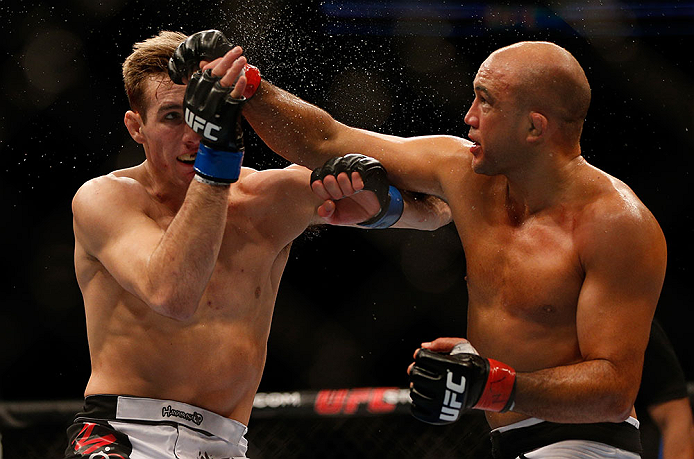 SEATTLE, WA - DECEMBER 08: (R-L) BJ Penn punches Rory MacDonald during their welterweight bout at the UFC on FOX event on December 8, 2012 at Key Arena in Seattle, Washington. (Photo by Josh Hedges/Zuffa LLC/Zuffa LLC via Getty Images) *** Local Caption *** BJ Penn; Rory MacDonald
