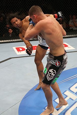 SEATTLE, WA - DECEMBER 08:  Benson Henderson (white trunks) kicks Nate Diaz during their lightweight championship bout at the UFC on FOX event on December 8, 2012  at Key Arena in Seattle, Washington.  (Photo by Ezra Shaw/Zuffa LLC/Zuffa LLC via Getty Images) *** Local Caption *** Benson Henderson; Nate Diaz