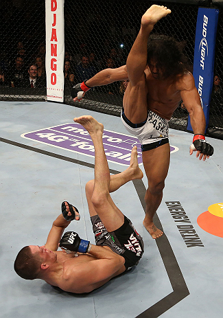SEATTLE, WA - DECEMBER 08:  Benson Henderson (white shorts) readies a kick towards Nate Diaz during their lightweight championship bout at the UFC on FOX event on December 8, 2012  at Key Arena in Seattle, Washington.  (Photo by Ezra Shaw/Zuffa LLC/Zuffa LLC via Getty Images) *** Local Caption *** Benson Henderson; Nate Diaz