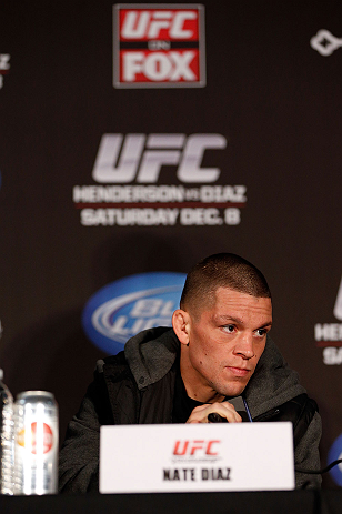 SEATTLE, WA - DECEMBER 06:  Nate Diaz interacts with media during the UFC on FOX press conference on December 6, 2012 at Key Arena in Seattle, Washington.  (Photo by Josh Hedges/Zuffa LLC/Zuffa LLC via Getty Images)