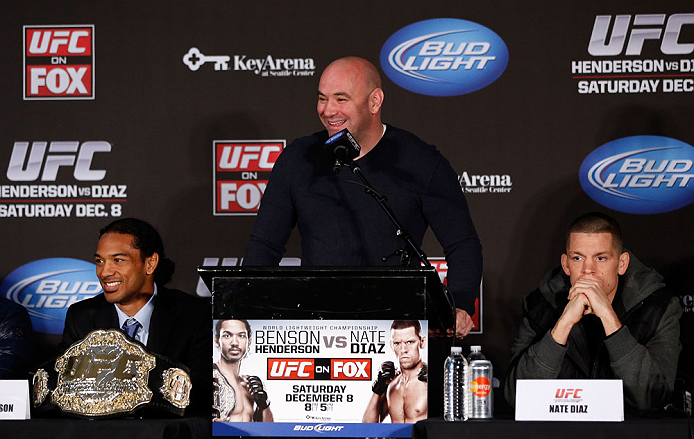 SEATTLE, WA - DECEMBER 06:  UFC President Dana White (C), flanked by Benson Henderson (L) and Nate Diaz, interacts with media during the UFC on FOX press conference on December 6, 2012  at Key Arena in Seattle, Washington.  (Photo by Josh Hedges/Zuffa LLC/Zuffa LLC via Getty Images)