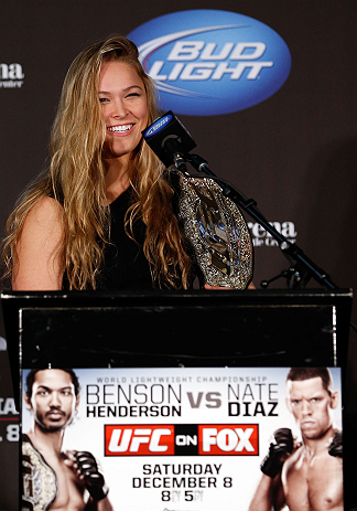 SEATTLE, WA - DECEMBER 06:  Ronda Rousey addresses the media after being presented with the UFC women&#39;s bantamweight championship during the UFC on FOX press conference on December 6, 2012 at Key Arena in Seattle, Washington.  (Photo by Josh Hedges/Zuffa LLC/Zuffa LLC via Getty Images)