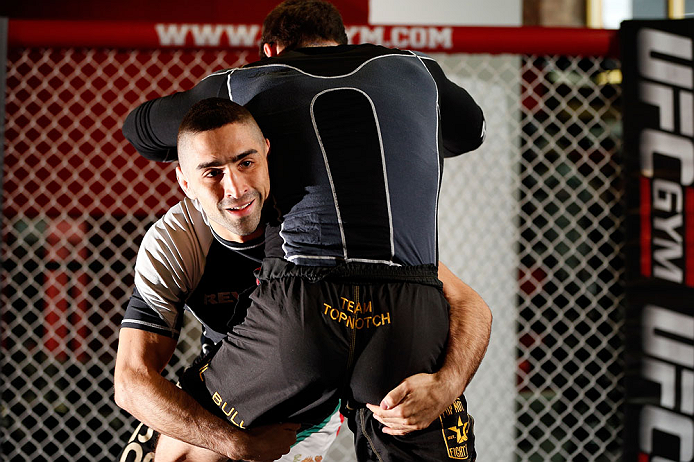 CHICAGO, IL - JANUARY 23:  Ricardo Lamas (L) conducts an open workout session for media on January 23, 2013 at UFC Gym in Chicago, Illinois. (Photo by Josh Hedges/Zuffa LLC/Zuffa LLC via Getty Images)