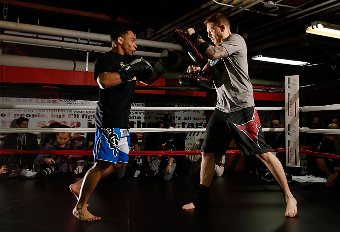 CHICAGO, IL - JANUARY 23:  John Dodson (L) conducts an open workout session for media on January 23, 2013 at UFC Gym in Chicago, Illinois. (Photo by Josh Hedges/Zuffa LLC/Zuffa LLC via Getty Images)