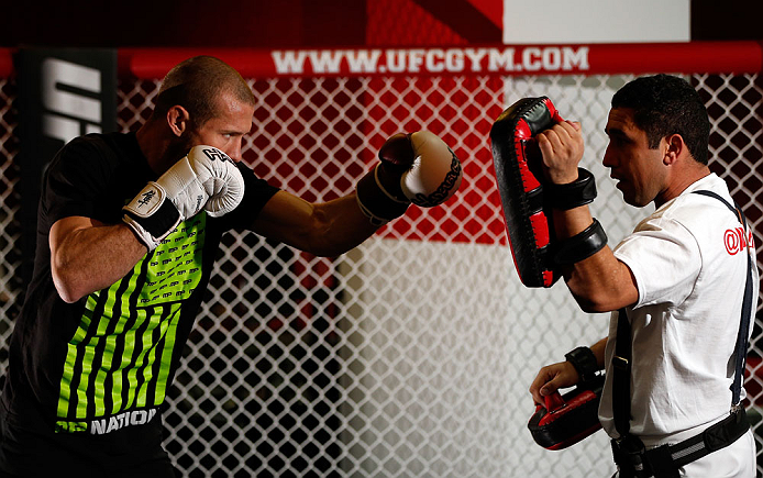 "CHICAGO, IL - JANUARY 23:  Donald ""Cowboy"" Cerrone (L) conducts an open workout session for media on January 23, 2013 at UFC Gym in Chicago, Illinois. (Photo by Josh Hedges/Zuffa LLC/Zuffa LLC via Getty Images)"