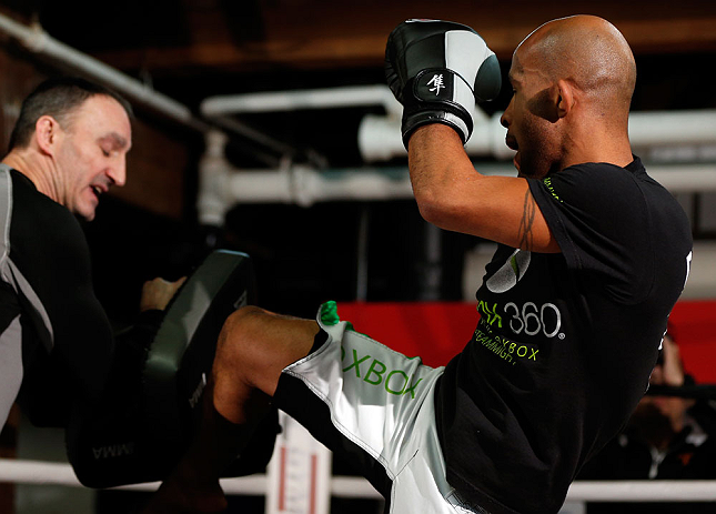 "CHICAGO, IL - JANUARY 23:  Demetrious ""Mighty Mouse"" Johnson (R) conducts an open workout session for media on January 23, 2013 at UFC Gym in Chicago, Illinois. (Photo by Josh Hedges/Zuffa LLC/Zuffa LLC via Getty Images)"