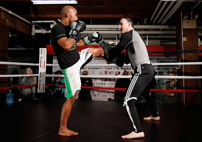 "CHICAGO, IL - JANUARY 23:  Demetrious ""Mighty Mouse"" Johnson (L) conducts an open workout session for media on January 23, 2013 at UFC Gym in Chicago, Illinois. (Photo by Josh Hedges/Zuffa LLC/Zuffa LLC via Getty Images)"
