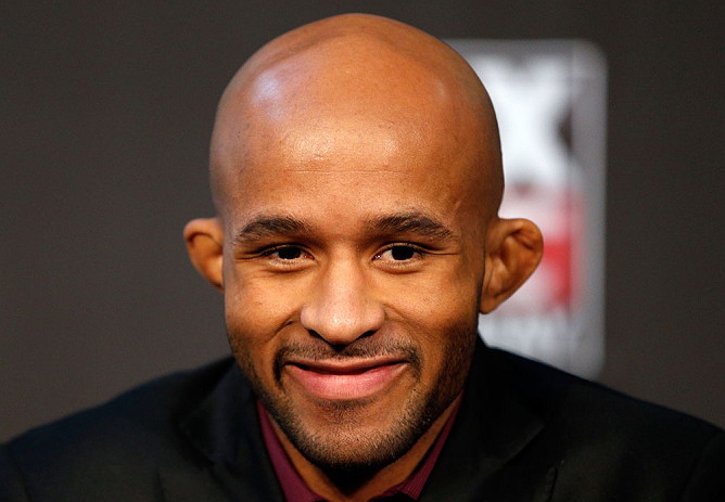 "CHICAGO, IL - JANUARY 24:  UFC flyweight champion Demetrious ""Mighty Mouse"" Johnson interacts with media during the UFC on FOX press conference on January 24, 2013 at the United Center in Chicago, Illinois. (Photo by Josh Hedges/Zuffa LLC/Zuffa LLC via Getty Images)"