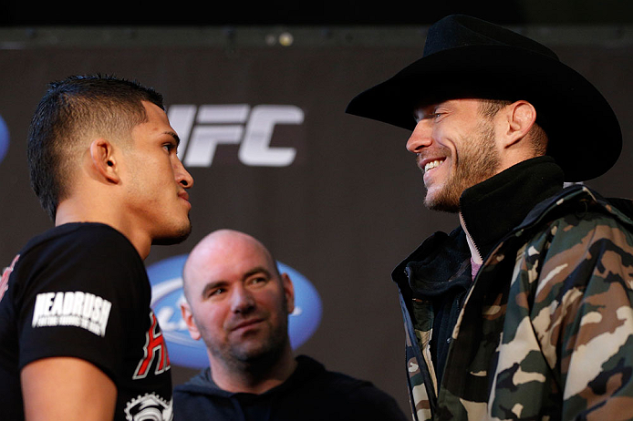 "CHICAGO, IL - JANUARY 24:  (L-R) Opponents Anthony Pettis and Donald ""Cowboy"" Cerrone face off during the UFC on FOX press conference on January 24, 2013 at the United Center in Chicago, Illinois. (Photo by Josh Hedges/Zuffa LLC/Zuffa LLC via Getty Images)"