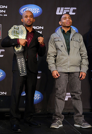 "CHICAGO, IL - JANUARY 24:  (L-R) Opponents Demetrious ""Mighty Mouse"" Johnson and John Dodson pose for photos during the UFC on FOX press conference on January 24, 2013 at the United Center in Chicago, Illinois. (Photo by Josh Hedges/Zuffa LLC/Zuffa LLC via Getty Images)"