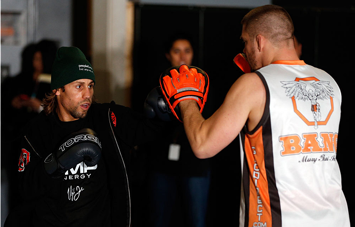 SACRAMENTO, CA - DECEMBER 11:  (L-R) Urijah Faber works out with head coach Duane Ludwig during an open training session for media at Ultimate Fitness on December 11, 2013 in Sacramento, California. (Photo by Josh Hedges/Zuffa LLC/Zuffa LLC via Getty Images)