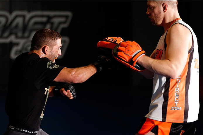 SACRAMENTO, CA - DECEMBER 11:  (L-R) Chad Mendes works out with head coach Duane Ludwig during an open training session for media at Ultimate Fitness on December 11, 2013 in Sacramento, California. (Photo by Josh Hedges/Zuffa LLC/Zuffa LLC via Getty Images)