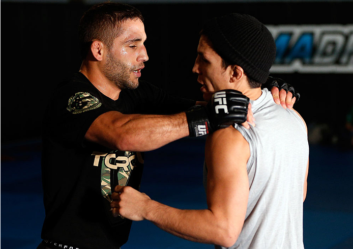 SACRAMENTO, CA - DECEMBER 11:  (L-R) Teammates Chad Mendes and Joseph Benavidez workout together during an open training session for media at Ultimate Fitness on December 11, 2013 in Sacramento, California. (Photo by Josh Hedges/Zuffa LLC/Zuffa LLC via Getty Images)