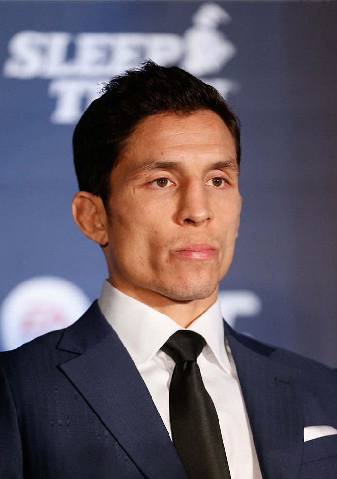 SACRAMENTO, CA - DECEMBER 12:  Joseph Benavidez interacts with media during the final pre-fight press conference before the UFC on FOX event at Sleep Train Arena on December 12, 2013 in Sacramento, California. (Photo by Josh Hedges/Zuffa LLC/Zuffa LLC via Getty Images)