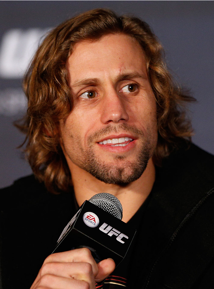 SACRAMENTO, CA - DECEMBER 12:  Urijah Faber interacts with media during the final pre-fight press conference before the UFC on FOX event at Sleep Train Arena on December 12, 2013 in Sacramento, California. (Photo by Josh Hedges/Zuffa LLC/Zuffa LLC via Getty Images)