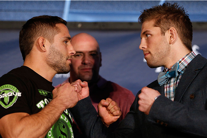 SACRAMENTO, CA - DECEMBER 12:  (L-R) Opponents Chad Mendes and Nik Lentz face off during the final pre-fight press conference before the UFC on FOX event at Sleep Train Arena on December 12, 2013 in Sacramento, California. (Photo by Josh Hedges/Zuffa LLC/Zuffa LLC via Getty Images)