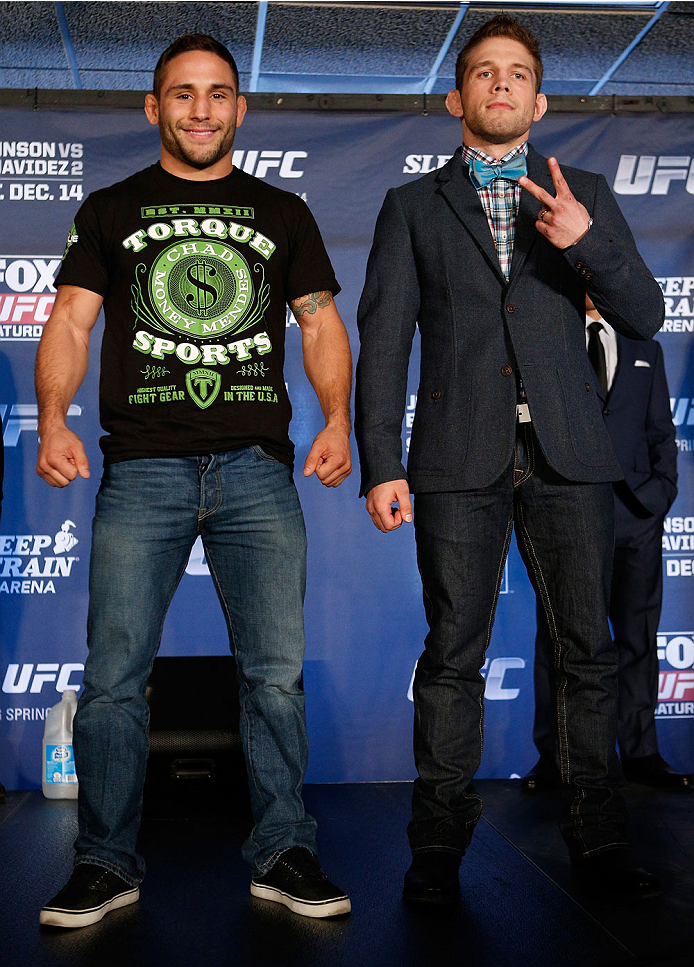 SACRAMENTO, CA - DECEMBER 12:  (L-R) Opponents Chad Mendes and Nik Lentz pose for photos during the final pre-fight press conference before the UFC on FOX event at Sleep Train Arena on December 12, 2013 in Sacramento, California. (Photo by Josh Hedges/Zuffa LLC/Zuffa LLC via Getty Images)