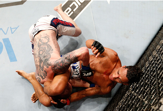 JARAGUA DO SUL, BRAZIL - FEBRUARY 15:  (R-L) Charles Oliveira secures a triangle choke submission against Andy Ogle in their featherweight fight during the UFC Fight Night event at Arena Jaragua on February 15, 2014 in Jaragua do Sul, Santa Catarina, Brazil. (Photo by Josh Hedges/Zuffa LLC/Zuffa LLC via Getty Images)