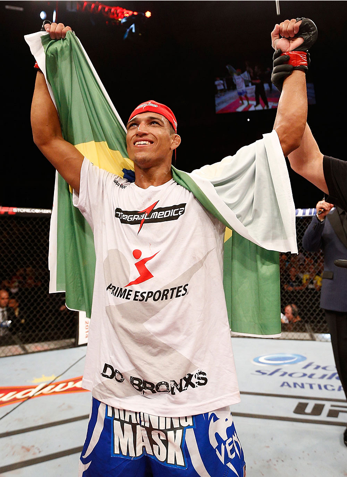 JARAGUA DO SUL, BRAZIL - FEBRUARY 15:  Charles Oliveira reacts after his submission victory over Andy Ogle in their featherweight fight during the UFC Fight Night event at Arena Jaragua on February 15, 2014 in Jaragua do Sul, Santa Catarina, Brazil. (Photo by Josh Hedges/Zuffa LLC/Zuffa LLC via Getty Images)