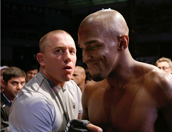 "JARAGUA DO SUL, BRAZIL - FEBRUARY 15:   (L-R) Former UFC welterweight champion Georges St-Pierre provides instruction to Francis Carmont before his middleweight fight against Ronaldo ""Jacare"" Souzaduring the UFC Fight Night event at Arena Jaragua on February 15, 2014 in Jaragua do Sul, Santa Catarina, Brazil. (Photo by Josh Hedges/Zuffa LLC/Zuffa LLC via Getty Images)"