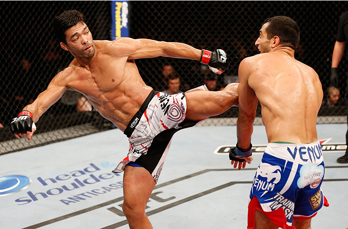 JARAGUA DO SUL, BRAZIL - FEBRUARY 15:  (L-R) Lyoto Machida kicks Gegard Mousasi in their middleweight fight during the UFC Fight Night event at Arena Jaragua on February 15, 2014 in Jaragua do Sul, Santa Catarina, Brazil. (Photo by Josh Hedges/Zuffa LLC/Zuffa LLC via Getty Images)