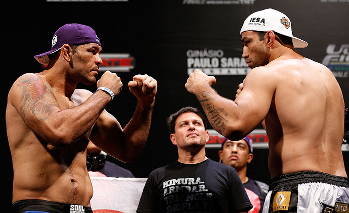 "FORTALEZA, BRAZIL - JUNE 07:  (L-R) Opponents Antonio Rodrigo ""Minotauro"" Nogueira and Fabricio Werdum face off during the UFC weigh-in at Paulo Sarasate Arena on June 7, 2013 in Fortaleza, Ceara, Brazil.  (Photo by Josh Hedges/Zuffa LLC/Zuffa LLC via Getty Images)"