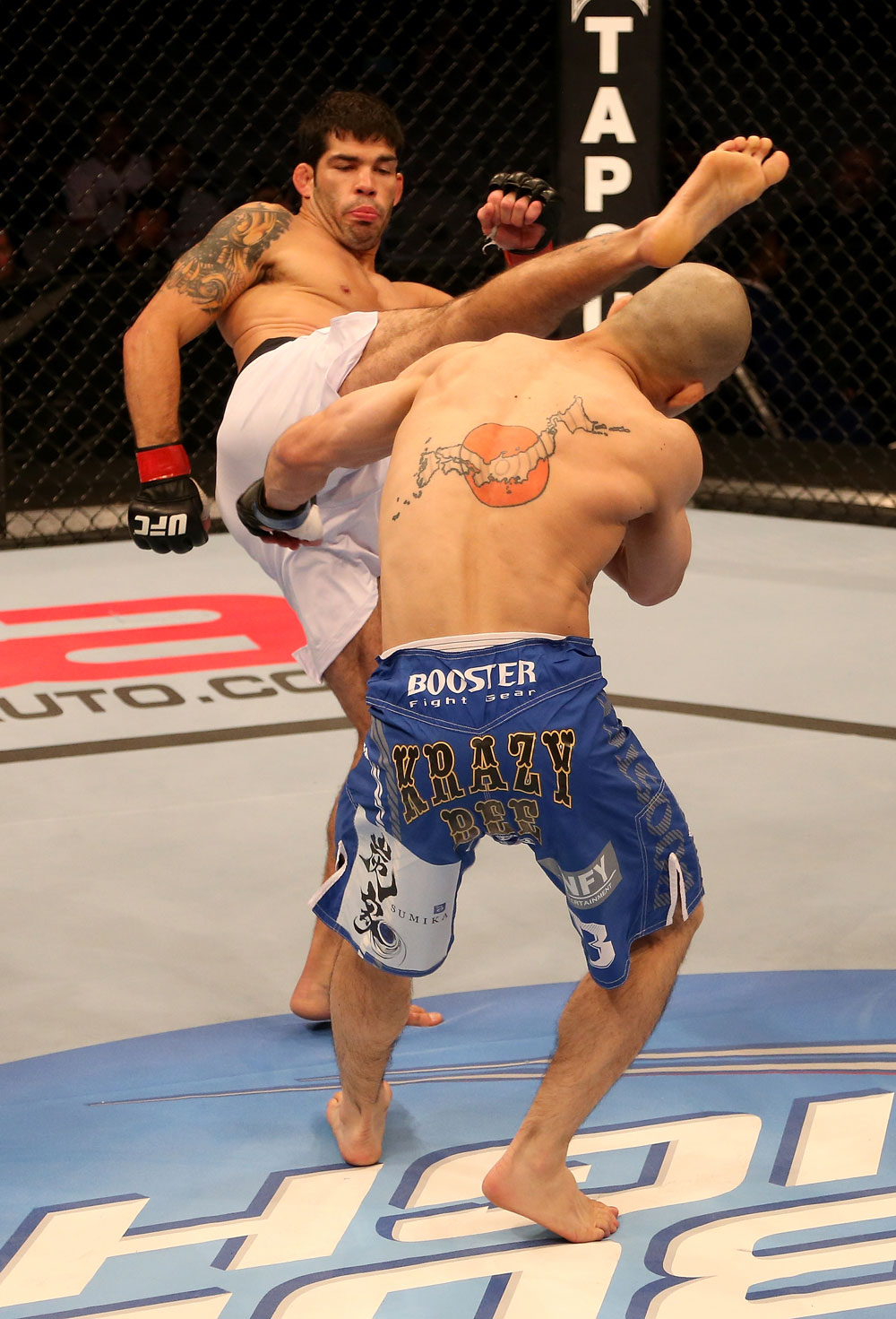SAN JOSE, CA - JULY 11:   Raphael Assuncao (white shorts) kicks Issei Tamura during their bantamweight bout at HP Pavilion on July 11, 2012 in San Jose, California.  (Photo by Ezra Shaw/Zuffa LLC/Zuffa LLC via Getty Images)  *** Local Caption *** Issei Tamura; Raphael Assuncao