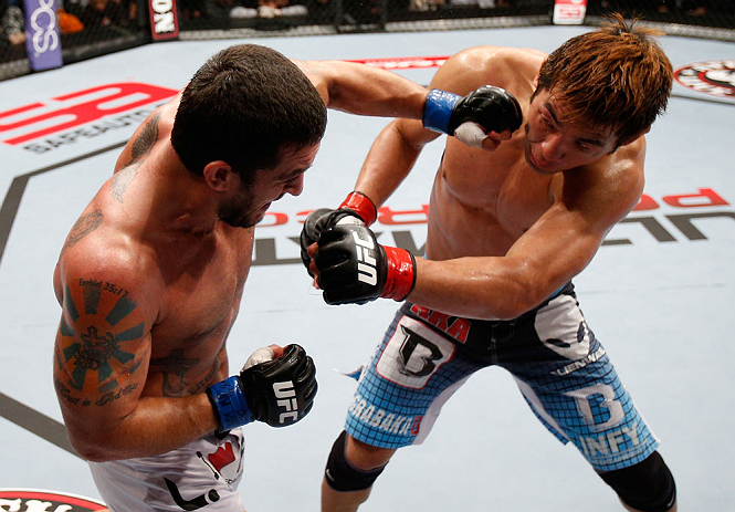 MACAU, MACAU - NOVEMBER 10: (L-R) Tom DeBlass punches Riki Fukuda during their middleweight bout at the UFC Macao event inside CotaiArena on November 10, 2012 in Macau, Macau. (Photo by Josh Hedges/Zuffa LLC/Zuffa LLC via Getty Images)