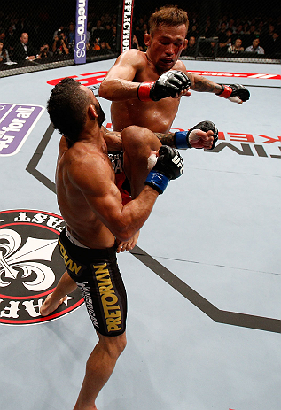 MACAU, MACAU - NOVEMBER 10: (R-L) Yasuhiro Urushitani lands a flying knee against John Lineker during their flyweight bout at the UFC Macao event inside CotaiArena on November 10, 2012 in Macau, Macau. (Photo by Josh Hedges/Zuffa LLC/Zuffa LLC via Getty Images)