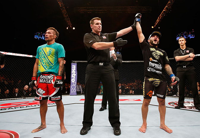 MACAU, MACAU - NOVEMBER 10: John Lineker (R) reacts after defeating Yasuhiro Urushitani (L) during their flyweight bout at the UFC Macao event inside CotaiArena on November 10, 2012 in Macau, Macau. (Photo by Josh Hedges/Zuffa LLC/Zuffa LLC via Getty Images)
