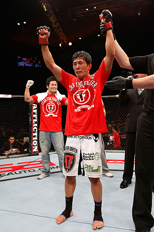 MACAU, MACAU - NOVEMBER 10:  Takeya Mizugaki reacts after defeating Jeff Hougland during their bantamweight bout at the UFC Macao event inside CotaiArena on November 10, 2012 in Macau, Macau.  (Photo by Josh Hedges/Zuffa LLC/Zuffa LLC via Getty Images)