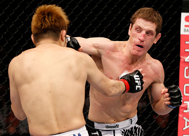 MACAU, MACAU - NOVEMBER 10: (R-L) Mac Danzig punches Takanori Gomi during their lightweight bout at the UFC Macao event inside CotaiArena on November 10, 2012 in Macau, Macau. (Photo by Josh Hedges/Zuffa LLC/Zuffa LLC via Getty Images)
