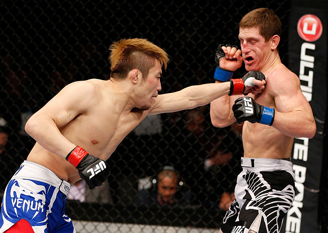 MACAU, MACAU - NOVEMBER 10: (L-R) Takanori Gomi punches Mac Danzig during their lightweight bout at the UFC Macao event inside CotaiArena on November 10, 2012 in Macau, Macau. (Photo by Josh Hedges/Zuffa LLC/Zuffa LLC via Getty Images)