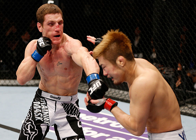 MACAU, MACAU - NOVEMBER 10: (L-R) Mac Danzig punches Takanori Gomi during their lightweight bout at the UFC Macao event inside CotaiArena on November 10, 2012 in Macau, Macau. (Photo by Josh Hedges/Zuffa LLC/Zuffa LLC via Getty Images)