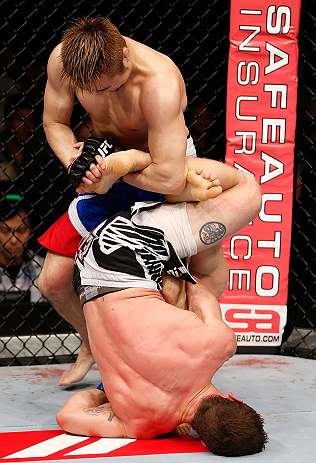 MACAU, MACAU - NOVEMBER 10: (L-R) Takanori Gomi and Mac Danzig trade leg lock attempts during their lightweight bout at the UFC Macao event inside CotaiArena on November 10, 2012 in Macau, Macau. (Photo by Josh Hedges/Zuffa LLC/Zuffa LLC via Getty Images)