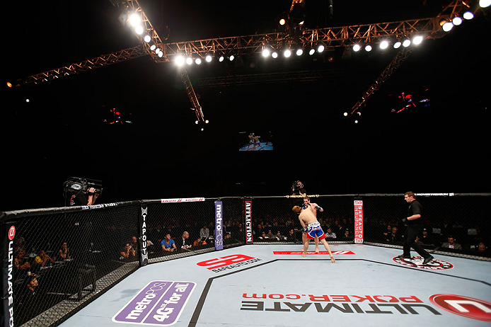 MACAU, MACAU - NOVEMBER 10: Takanori Gomi (blue shorts) punches Mac Danzig during their lightweight bout at the UFC Macao event inside CotaiArena on November 10, 2012 in Macau, Macau. (Photo by Josh Hedges/Zuffa LLC/Zuffa LLC via Getty Images)