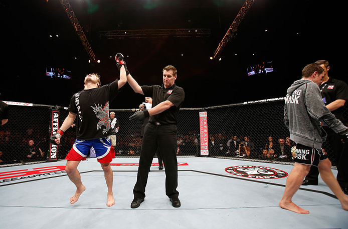 MACAU, MACAU - NOVEMBER 10: Takanori Gomi (L) reacts after defeating Mac Danzig during their lightweight bout at the UFC Macao event inside CotaiArena on November 10, 2012 in Macau, Macau. (Photo by Josh Hedges/Zuffa LLC/Zuffa LLC via Getty Images)