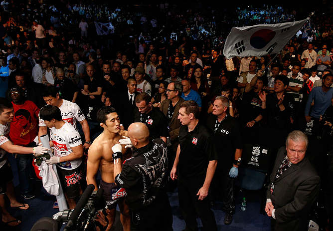 MACAU, MACAU - NOVEMBER 10: Dong Hyun Kim prepares to enter the Octagon before his welterweight bout against Paulo Thiago at the UFC Macao event inside CotaiArena on November 10, 2012 in Macau, Macau. (Photo by Josh Hedges/Zuffa LLC/Zuffa LLC via Getty Images)