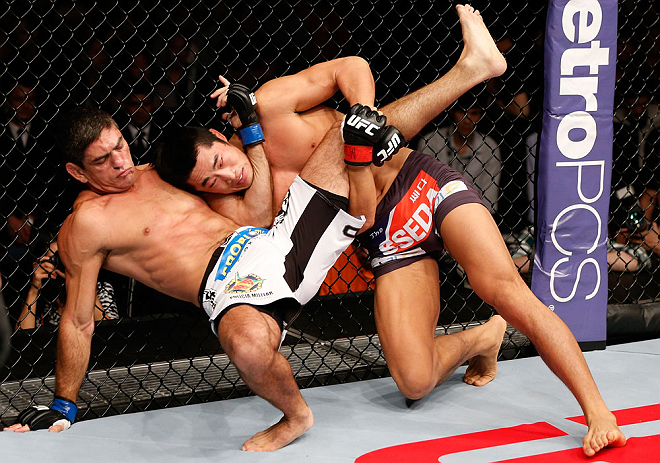 MACAU, MACAU - NOVEMBER 10: (R-L) Dong Hyun Kim attempts to take down Paulo Thiago during their welterweight bout at the UFC Macao event inside CotaiArena on November 10, 2012 in Macau, Macau. (Photo by Josh Hedges/Zuffa LLC/Zuffa LLC via Getty Images)