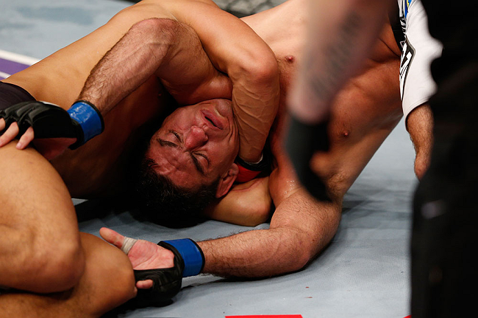 MACAU, MACAU - NOVEMBER 10: (R-L) Paulo Thiago fights off a choke attempt by Dong Hyun Kim during their welterweight bout at the UFC Macao event inside CotaiArena on November 10, 2012 in Macau, Macau. (Photo by Josh Hedges/Zuffa LLC/Zuffa LLC via Getty Images)