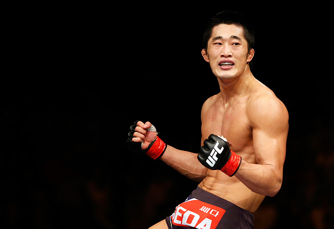 MACAU, MACAU - NOVEMBER 10: Dong Hyun Kim reacts after defeating Paulo Thiago during their welterweight bout at the UFC Macao event inside CotaiArena on November 10, 2012 in Macau, Macau. (Photo by Josh Hedges/Zuffa LLC/Zuffa LLC via Getty Images)