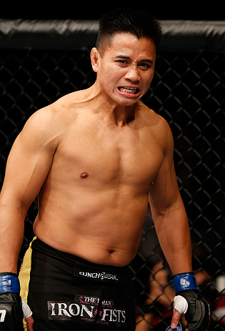 MACAU, MACAU - NOVEMBER 10: Cung Le stands in the Octagon before his middleweight bout against Rich Franklin at the UFC Macao event inside CotaiArena on November 10, 2012 in Macau, Macau. (Photo by Josh Hedges/Zuffa LLC/Zuffa LLC via Getty Images)