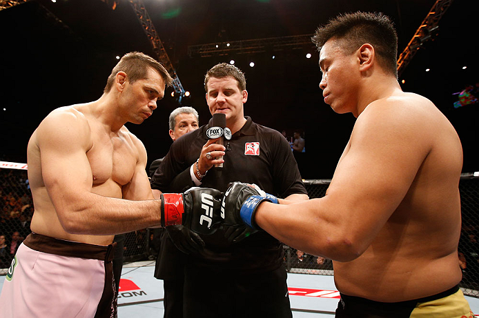 MACAU, MACAU - NOVEMBER 10: Opponents Rich Franklin (L) and Cung Le (R) touch gloves before their middleweight bout at the UFC Macao event inside CotaiArena on November 10, 2012 in Macau, Macau. (Photo by Josh Hedges/Zuffa LLC/Zuffa LLC via Getty Images)