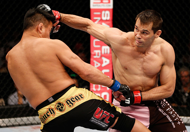 MACAU, MACAU - NOVEMBER 10: (R-L) Rich Franklin punches Cung Le during their middleweight bout at the UFC Macao event inside CotaiArena on November 10, 2012 in Macau, Macau. (Photo by Josh Hedges/Zuffa LLC/Zuffa LLC via Getty Images)