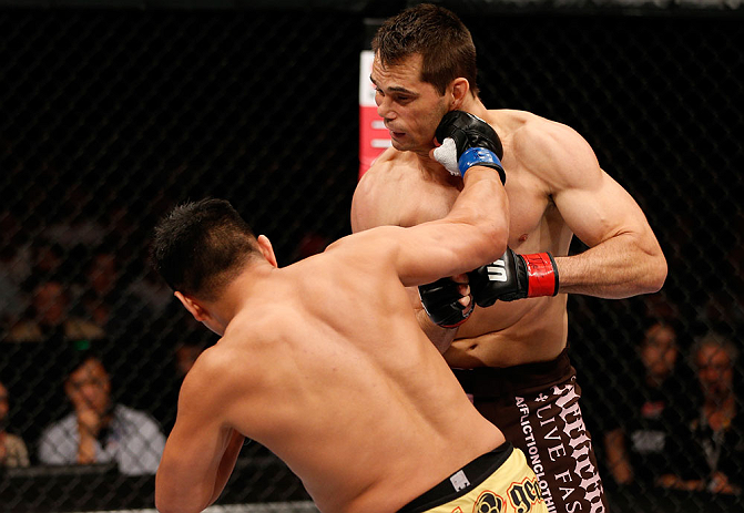 MACAU, MACAU - NOVEMBER 10: (L-R) Cung Le knocks out Rich Franklin with a punch during their middleweight bout at the UFC Macao event inside CotaiArena on November 10, 2012 in Macau, Macau. (Photo by Josh Hedges/Zuffa LLC/Zuffa LLC via Getty Images)