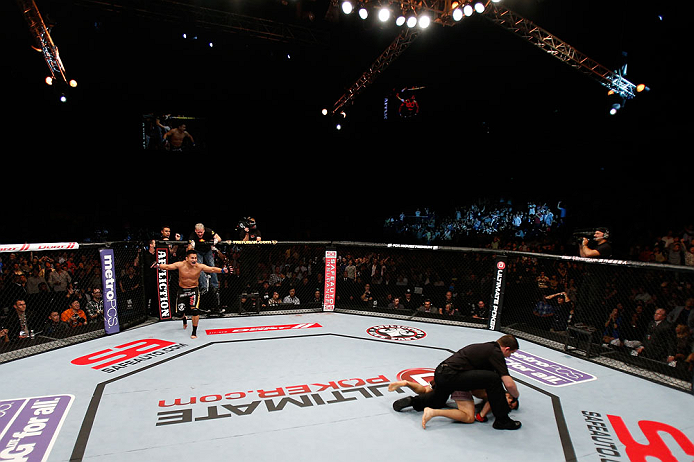 MACAU, MACAU - NOVEMBER 10: Cung Le (L) reacts after knocking out Rich Franklin during their middleweight bout at the UFC Macao event inside CotaiArena on November 10, 2012 in Macau, Macau. (Photo by Josh Hedges/Zuffa LLC/Zuffa LLC via Getty Images)