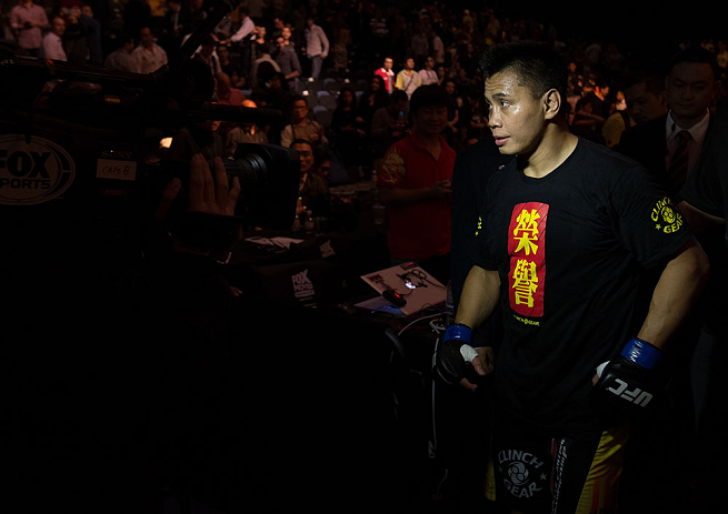 MACAU, MACAU - NOVEMBER 10:  Cung Le exits the arena after knocking out Rich Franklin during their middleweight bout at the UFC Macao event inside CotaiArena on November 10, 2012 in Macau, Macau.  (Photo by Josh Hedges/Zuffa LLC/Zuffa LLC via Getty Images)